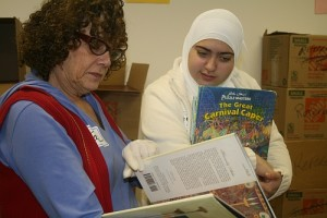 Volunteers sort books for Bookstock as a part of Mitzvah Day, December 25.