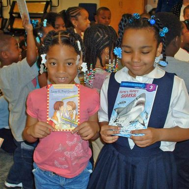 Students with books donated from Bookstock with the Detroit Jewish Coalition for Literacy (DJCL)