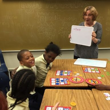 A Bookstock Volunteer tutors students at Coleman E. Young School in Detroit